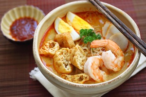 Curry laksa - eat with a spoon to slurp up the delicious broth and fried tofu puffs (click for recipe from rasamalaysia.com)